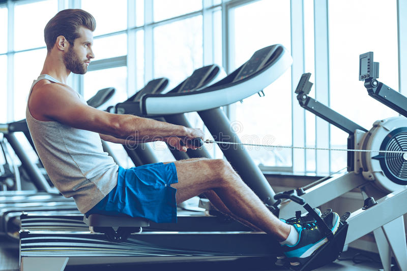 Rowing with power. royalty free stock photo