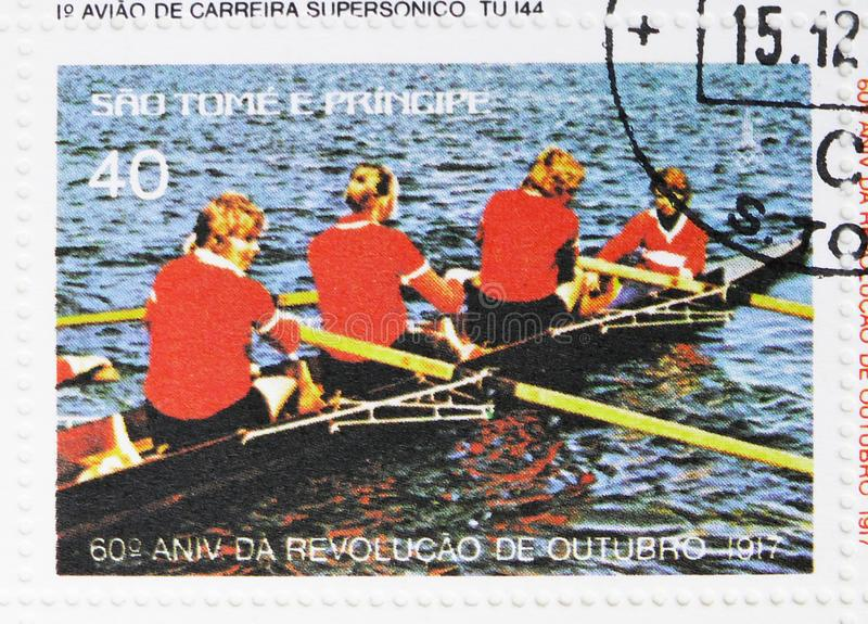 Rowing regatta, 60th anniversary of the October Revolution serie, circa 1977. MOSCOW, RUSSIA - JULY 25, 2019: Postage stamp printed in Sao Tome and Principe stock photography