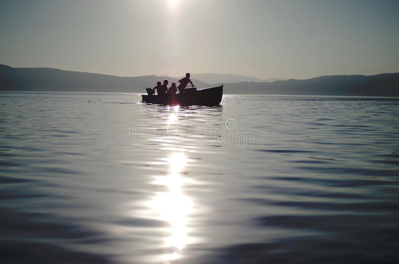 Rowing a small boat stock photography