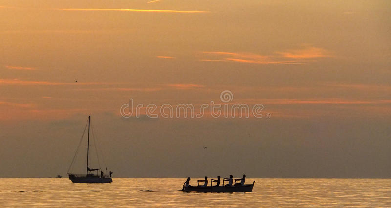 Rowing at Sunset royalty free stock photos