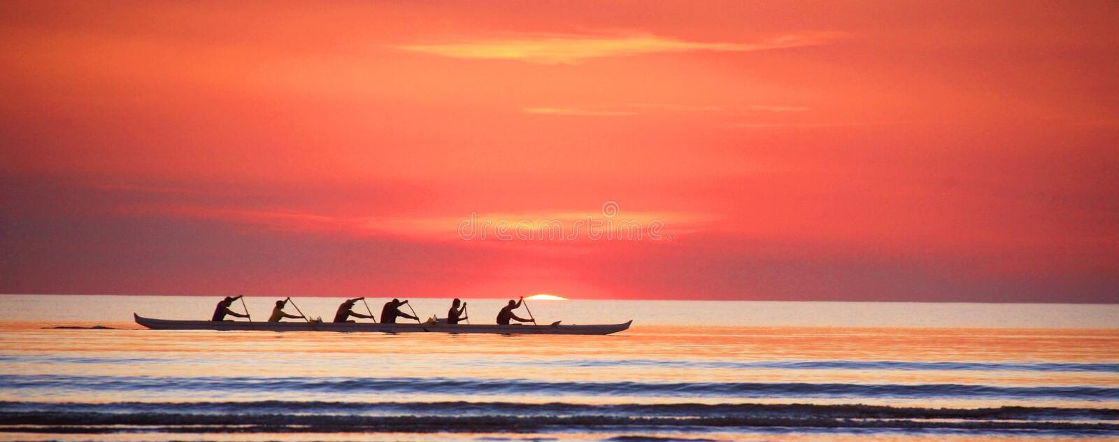 Rowing at sunset on the Indian Ocean, western Australia. Rowing during the sunset on Indian Ocean. Picture taken in Broome, Western Australia royalty free stock image