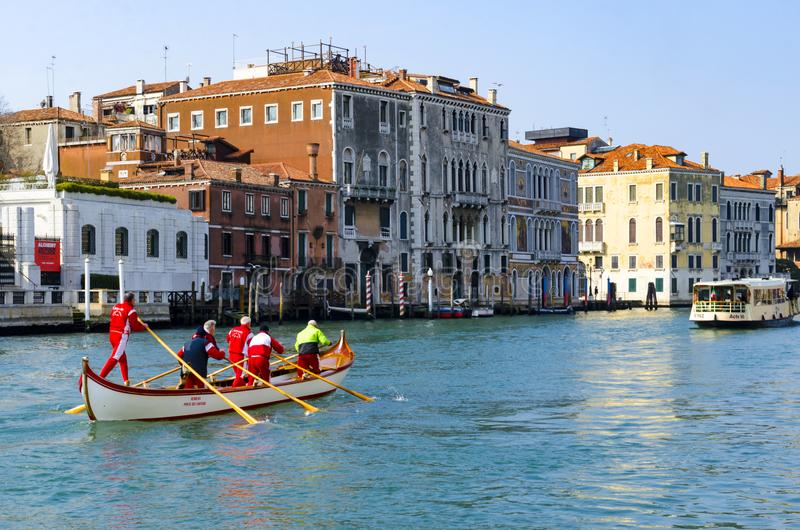 Rowing team durint training at Canal Grande, Venice, Italy royalty free stock photos