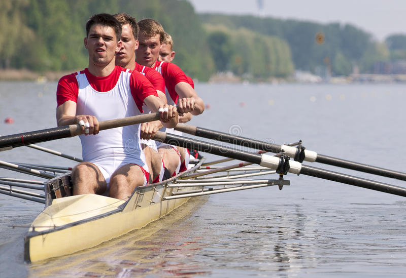 Rowing team during the start stock photos