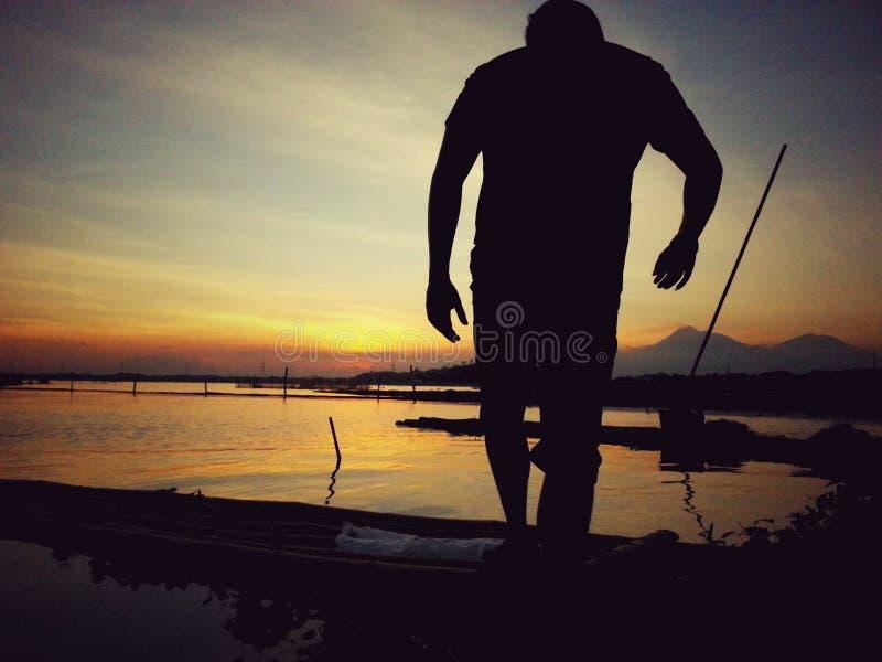 Rowo-jombor Sonnenuntergang lizenzfreie stockfotos