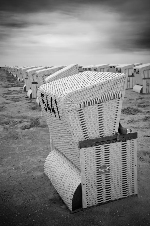 Rows Of Abandoned Roofed Wicker Beach Chairs Stock Photography