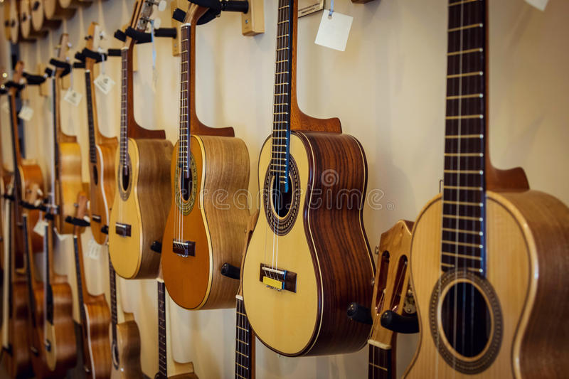 Download Rows Of Acoustic Guitars On The Wall Stock Photo - Image: 83723682