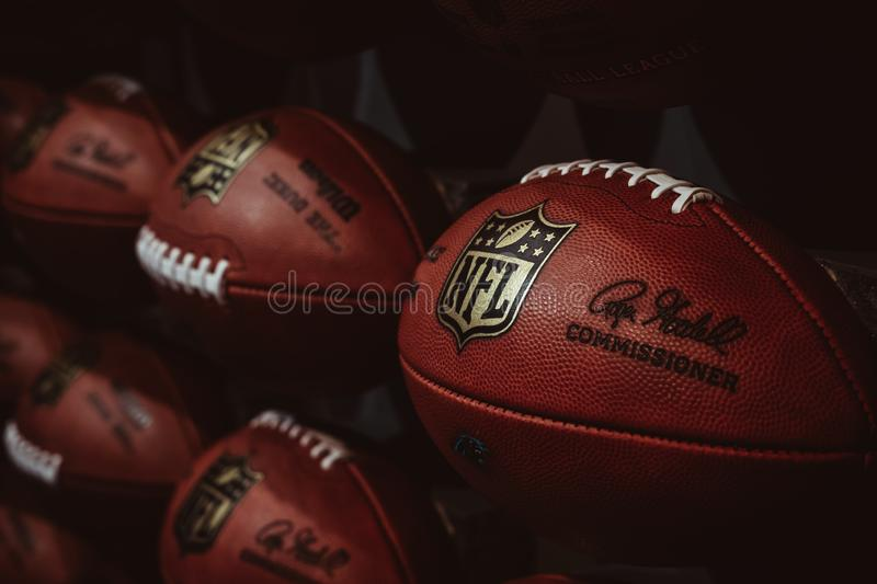 Rows of american football balls in NFL Experience in Times Square, New York. A first-of-its-kind live action attraction, combining interactive games and 4D royalty free stock images