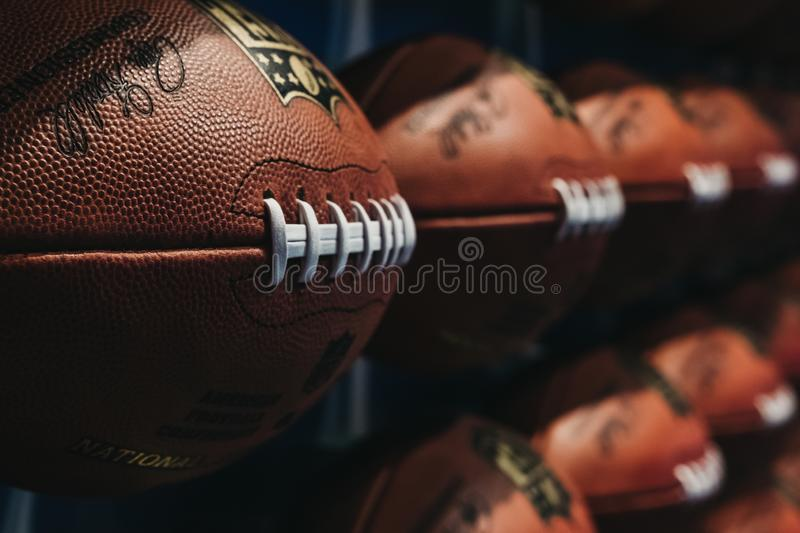 Rows of american football balls in NFL Experience in Times Square, New York. A first-of-its-kind live action attraction, combining interactive games and 4D stock photo