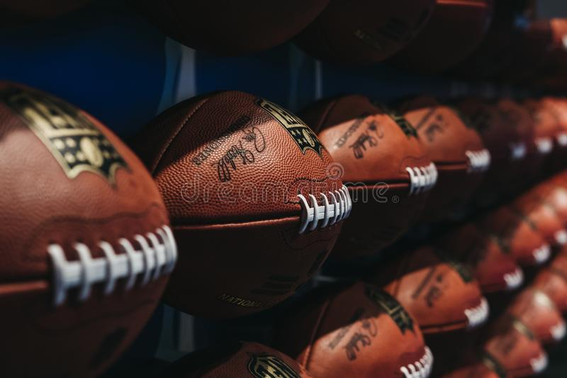 Rows of american football balls in NFL Experience in Times Square, New York. A first-of-its-kind live action attraction, combining interactive games and 4D royalty free stock photo