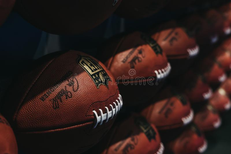 Rows of american football balls in NFL Experience in Times Square, New York. A first-of-its-kind live action attraction, combining interactive games and 4D royalty free stock photos