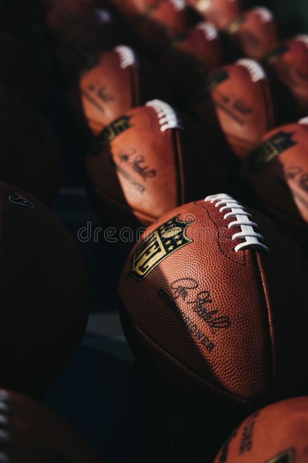 Rows of american football balls in NFL Experience in Times Square, New York, USA. New York, USA - MAY 28, 2018: Rows of american football balls in NFL Experience royalty free stock photography