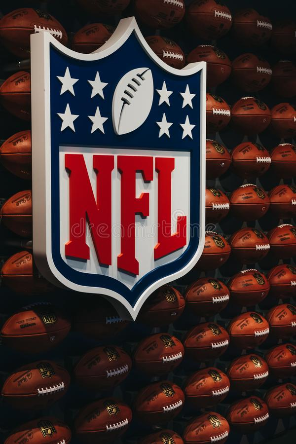 Rows of american football balls in NFL Experience in Times Square, New York, USA. New York, USA - MAY 28, 2018: Rows of american football balls in NFL Experience stock image
