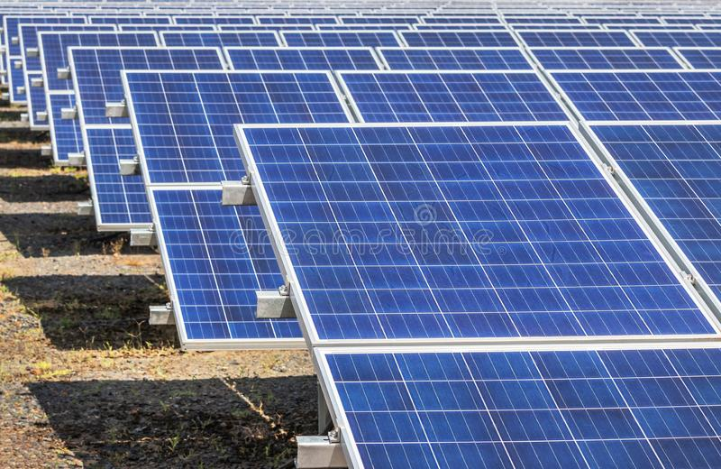Rows array of polycrystalline silicon solar cells or photovoltaics cell in solar power plant systems station. Convert light energy from the sun into electricity royalty free stock photography