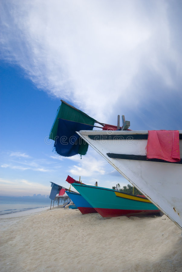 Rows of boat under blue skies royalty free stock image
