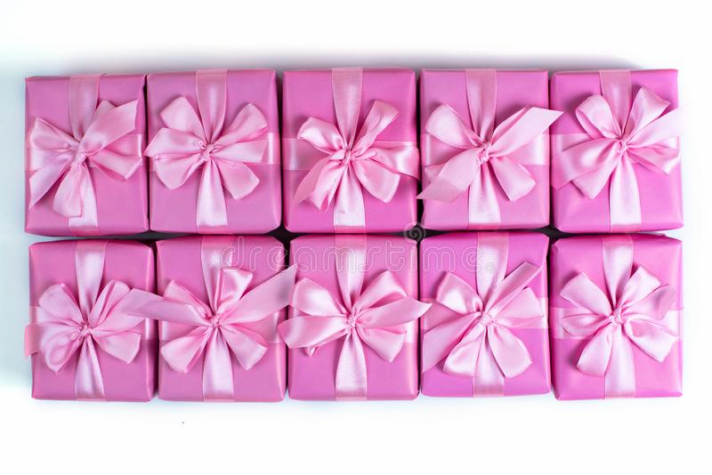 Rows of boxes with gifts decoration ribbon satin bow pink A top view of Flat lay stock photos