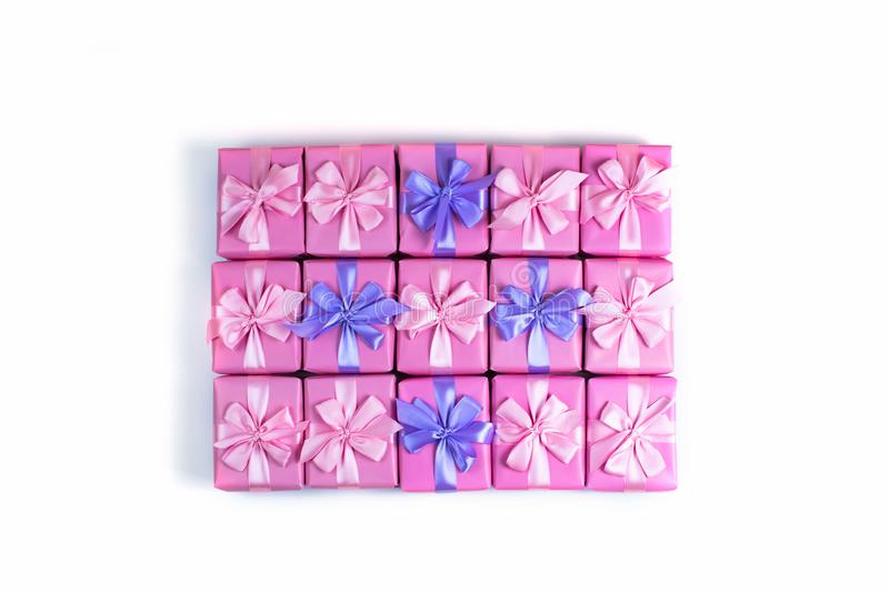 Rows of boxes with gifts decoration ribbon satin bow pink A top view of Flat lay royalty free stock photo