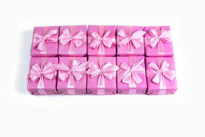 Rows of boxes with gifts decoration ribbon satin bow pink A top view of Flat lay stock images