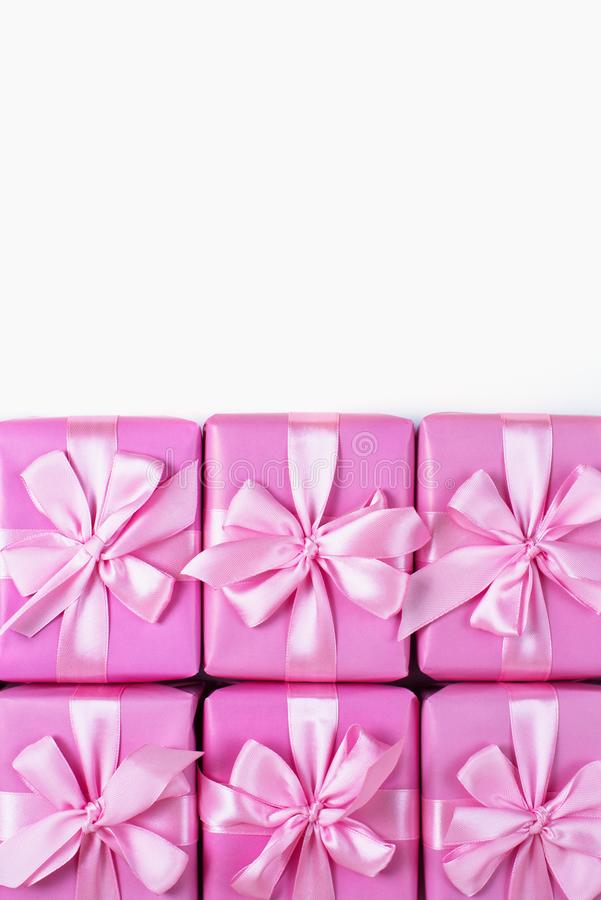 Rows of boxes six with gifts decoration ribbon satin bow pink A top view of Flat lay stock images