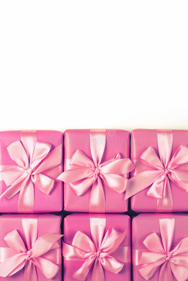 Rows of boxes six with gifts decoration ribbon satin bow pink A top view of Flat lay royalty free stock photos