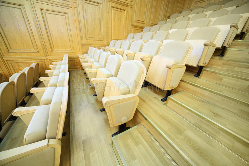Rows of chairs inside big light hall