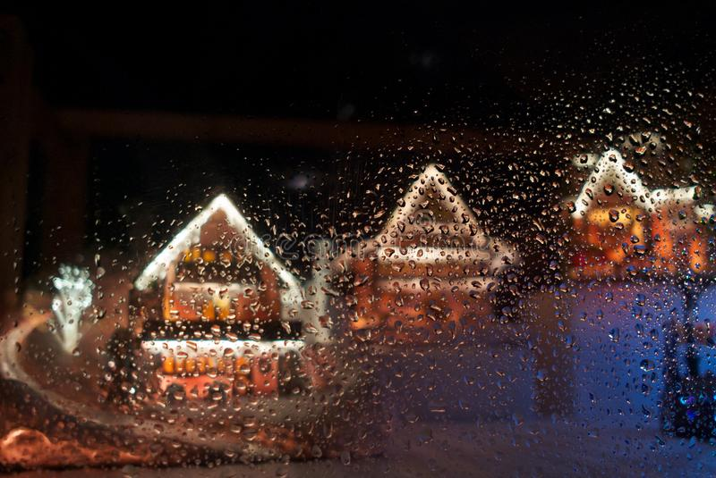 Rows of Christmas ginger bread house behind dews glass. stock images