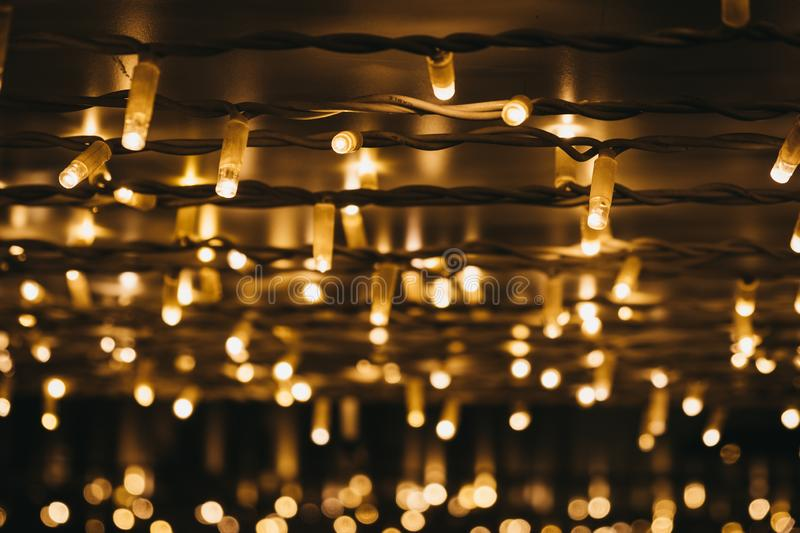 Rows of Christmas lights at night, selective focus stock photos