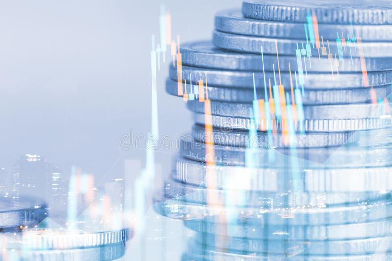 Rows of coin and graph of stock market stock image