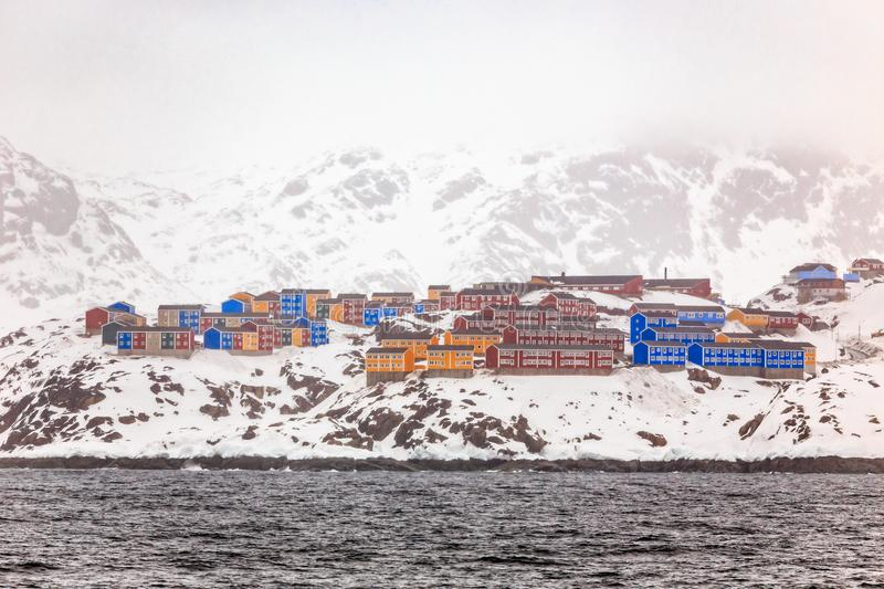Rows of colorful Inuit living houses of Sisimiut, on the snow rocks, Greenland stock photo