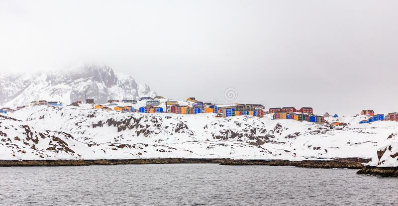 Rows of colorful Inuit living houses of Sisimiut town, on the steep rocks royalty free stock image