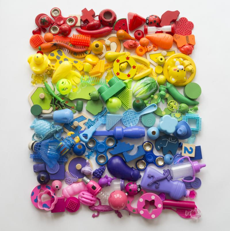 Rows of colorful rainbow toy bears.Very many kids toys rainbow color.Kids toys frame on white background. Top view. Flat lay. Very many kids toys rainbow color stock photo