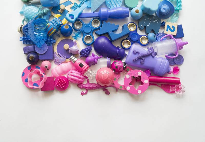 Rows of colorful rainbow toy bears.Very many kids toys rainbow color.Kids toys frame on white background. Top view. Flat lay. Very many kids toys rainbow color stock photos