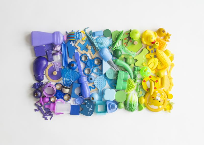 Rows of colorful rainbow toy bears.Very many kids toys rainbow color.Kids toys frame on white background. Top view. Flat lay. Very many kids toys rainbow color stock images