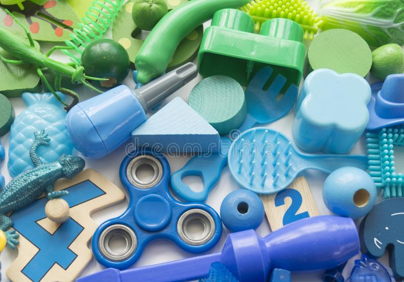 Rows of colorful rainbow toy bears.Very many kids toys rainbow color.Kids toys frame on white background. Top view. Flat lay. Very many kids toys rainbow color royalty free stock photo