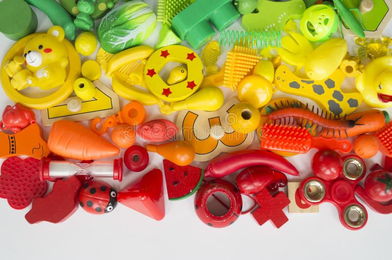 Rows of colorful rainbow toy bears.Very many kids toys rainbow color.Kids toys frame on white background. Top view. Flat lay. Very many kids toys rainbow color royalty free stock image