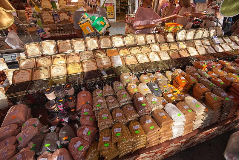 Rows of colourful spices and teas on Spanish market stall. stock photography