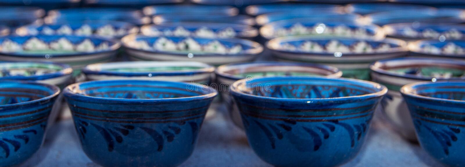 Rows of cups with traditional uzbekistan ornament in Bukhara, Uzbekistan, Central Asia. Silk Road. Rows of cups with traditional uzbekistan ornament on a street stock image