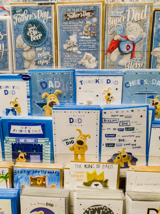Fathers day cards on display in a store for sale in the UK. Rows of different cards available in preperation for Fathers Day in the UK 2019 royalty free stock images
