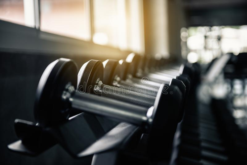 Rows of dumbbell black set in fitness gym., Sport bodybuilder weight lifting equipment for exercising arms muscular., Healthy royalty free stock photos