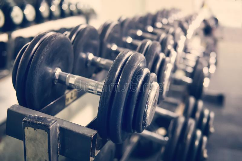 Rows of dumbbells in the gym with hign contrast and monochrome color tone stock images