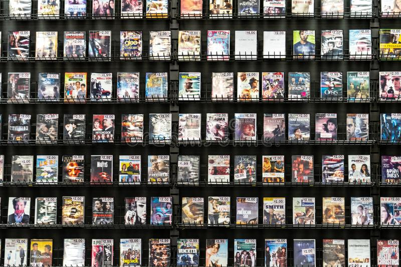 AUGUST 12 2018 - FAIRBANKS ALASKA:Shelves of DVD movie rentals at a Blockbuster Video store. Rows of DVD rental movies for sale at a going out of business royalty free stock photos
