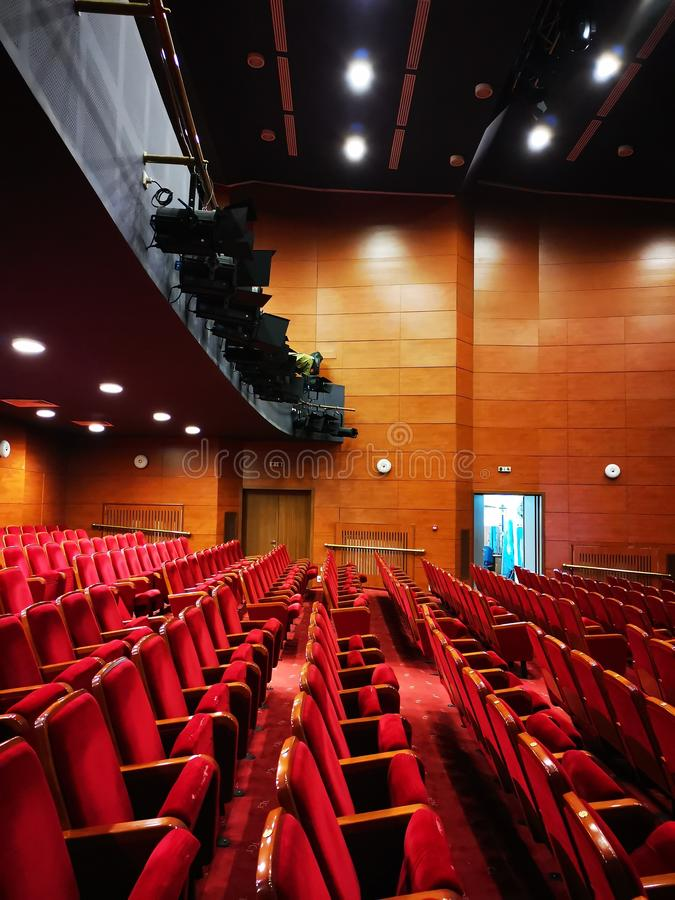 Rows of empty seats in a theater stock photography
