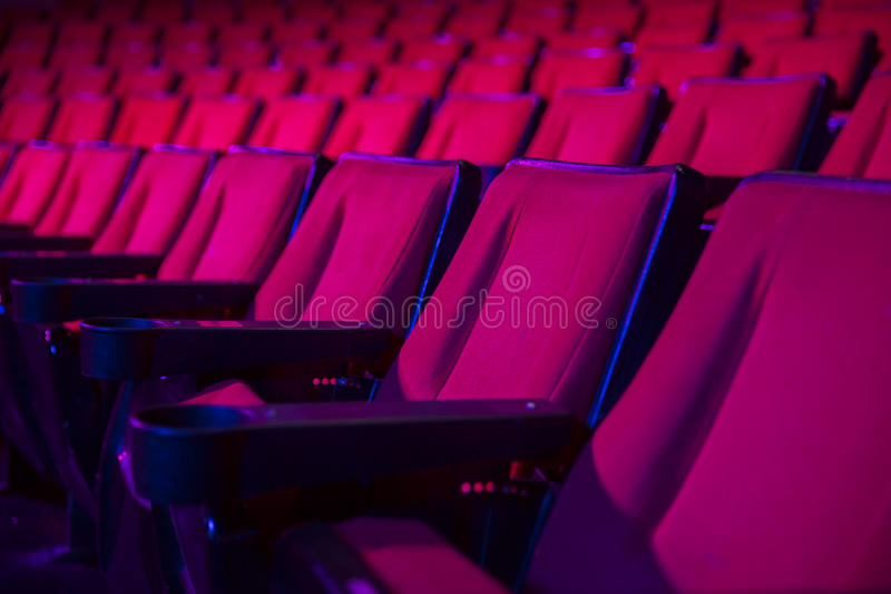 Rows of empty theater seats stock photos