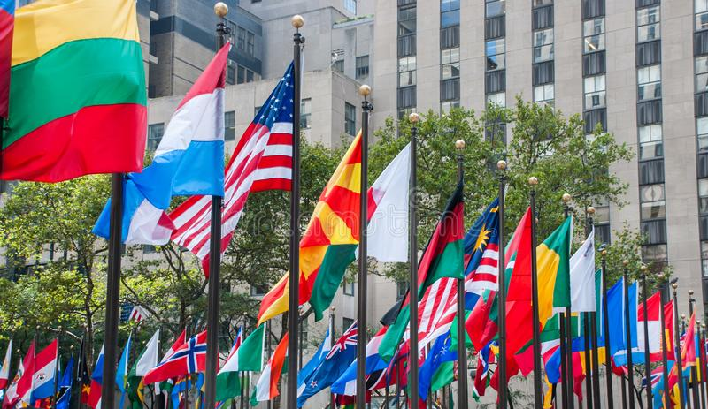 Rows of flags of all nations next to UN in New York City royalty free stock photos