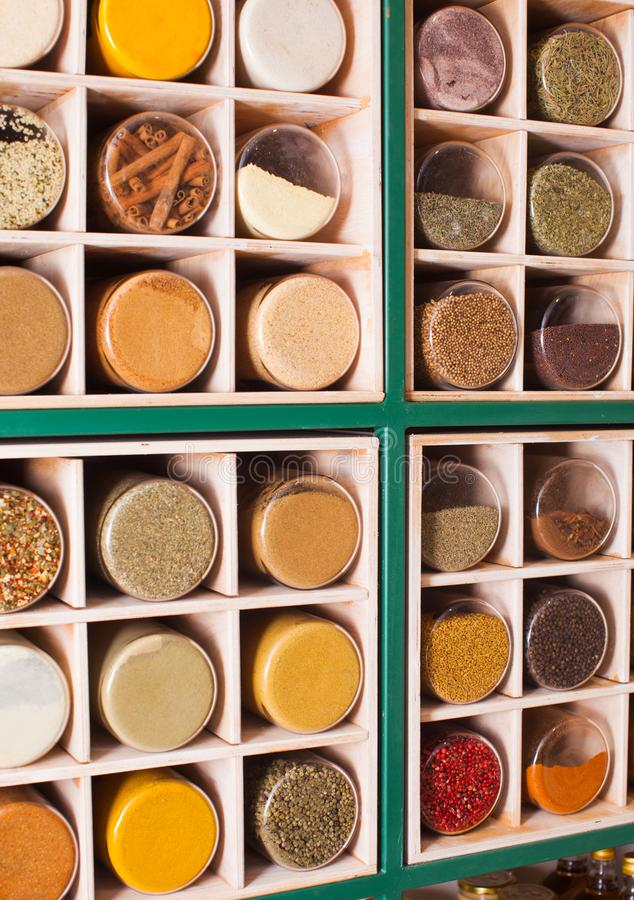 Rows of glasses with grinned herbs and spices royalty free stock image