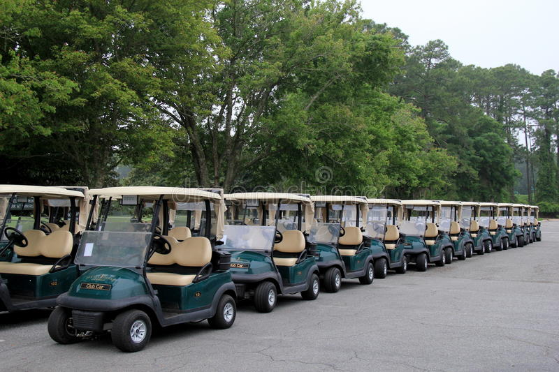 Rows of golf carts, lined up for the day,Jekyll Island Golf Club,Georgia,2015. Neat and orderly rows of golf carts lined up for people to come play, Jekyll stock images