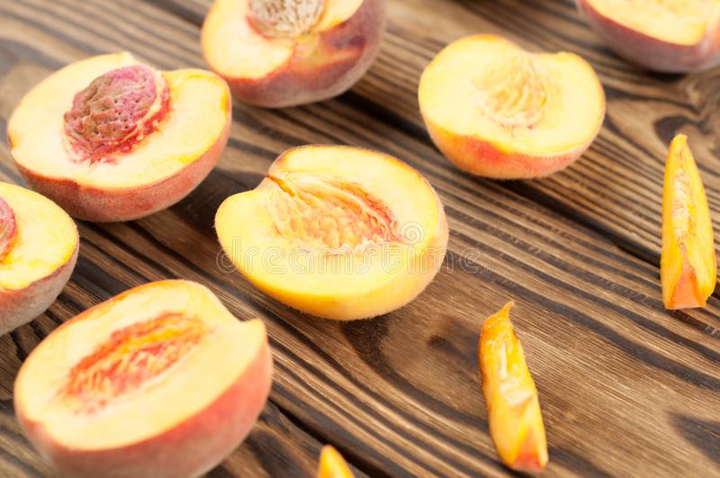 Rows of halves of peach and slices of peach stock photo
