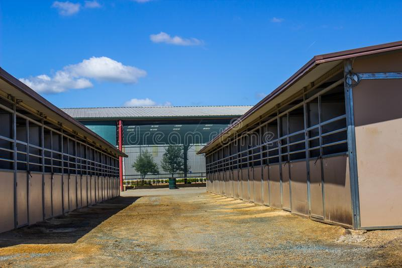 Horse Stalls Outside Equestrian Arena. Rows Of Horse Stalls Outside Large Equestrian Arena And Pavilion stock image