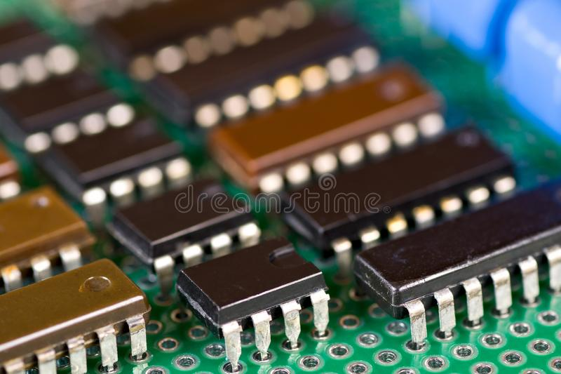Rows of integral circuits on Printed Circuit Board. Close-up stock photos