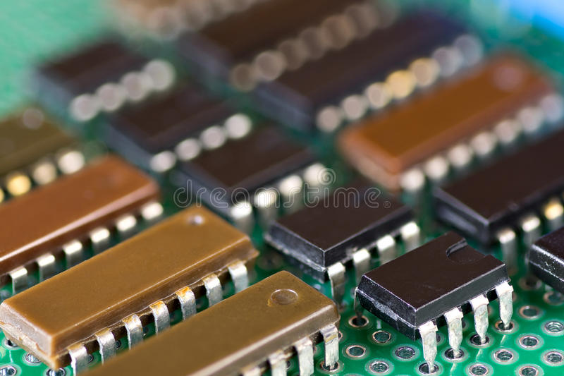 Rows of integral circuits on Printed Circuit Board. Close-up royalty free stock images