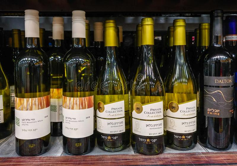 Rows of israeli wine bottles for sale on shelf at food supermarket royalty free stock images